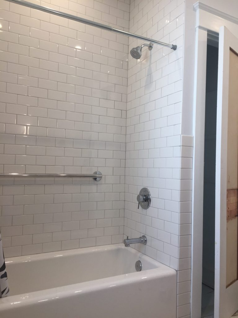 white subway tile crisp and clean chrome fixtures bright